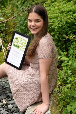 Lowri with her award in garden smaller res