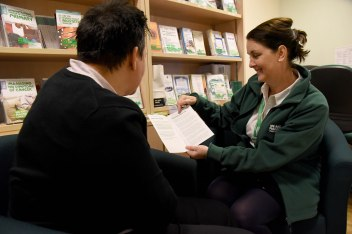 Rachel showing leaflet to visitor 4